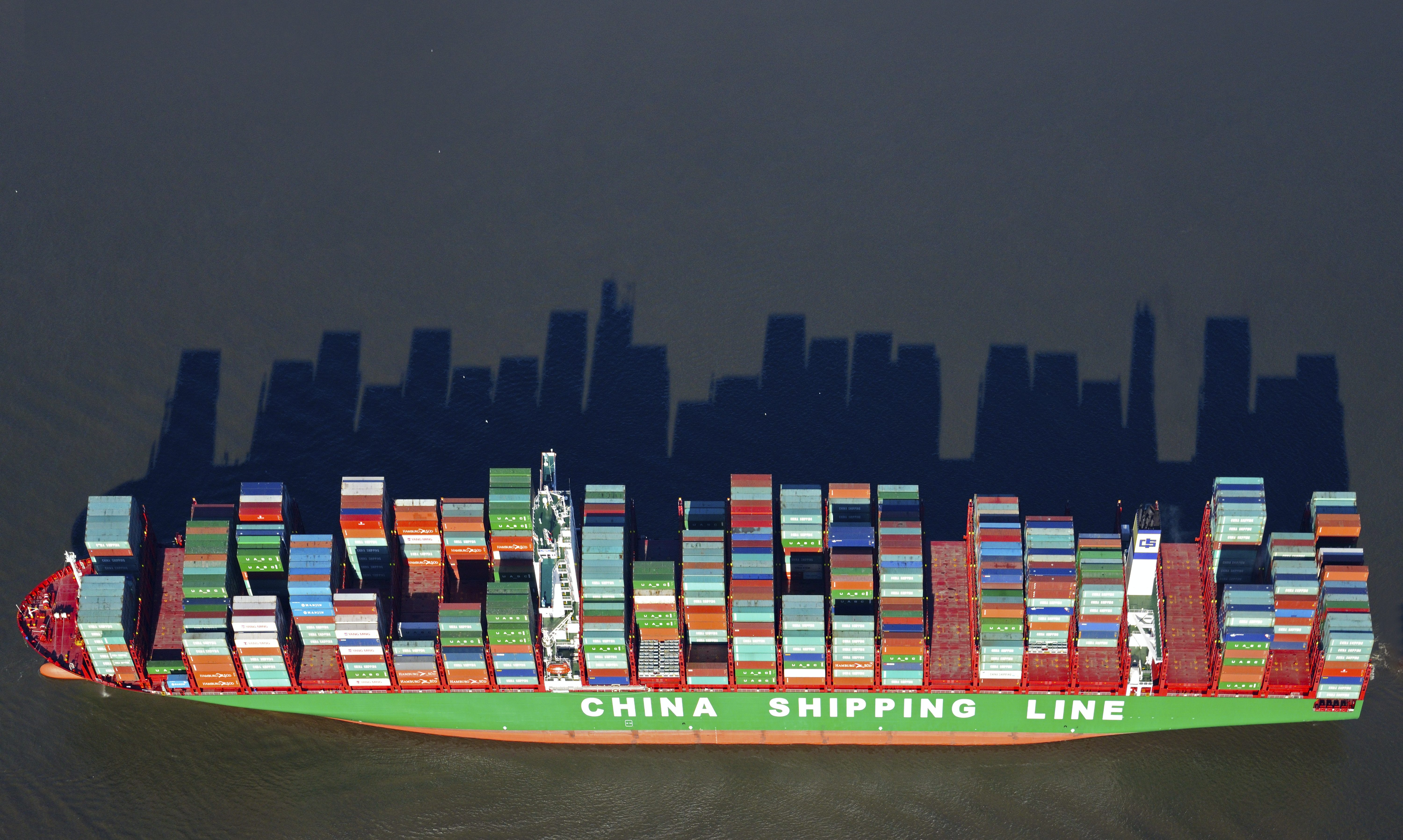 Stacked container casting long shadows, China Shipping Line container ship on the river Elbe, Hamburg, GermanyVARIOUS