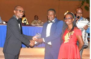 Mr Kwabena Ofosu Appiah (left) immediate past President of GIFF presenting the award to Mr Terrison