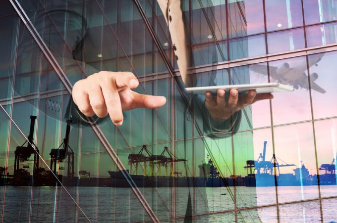 Double Exposure of Businessman with Digital Tablet and Port Carg