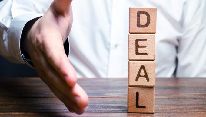 The businessman holds out his hand to make a deal. Concept of a contract or deal, making an offer. Signing or renewing a contract. Come to universal consensus. Diplomatic and political success.