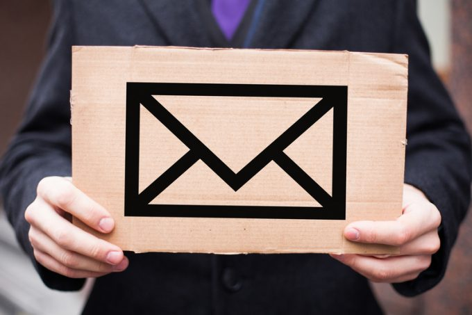 The concept of postal services and letters, mail. A man in a sui