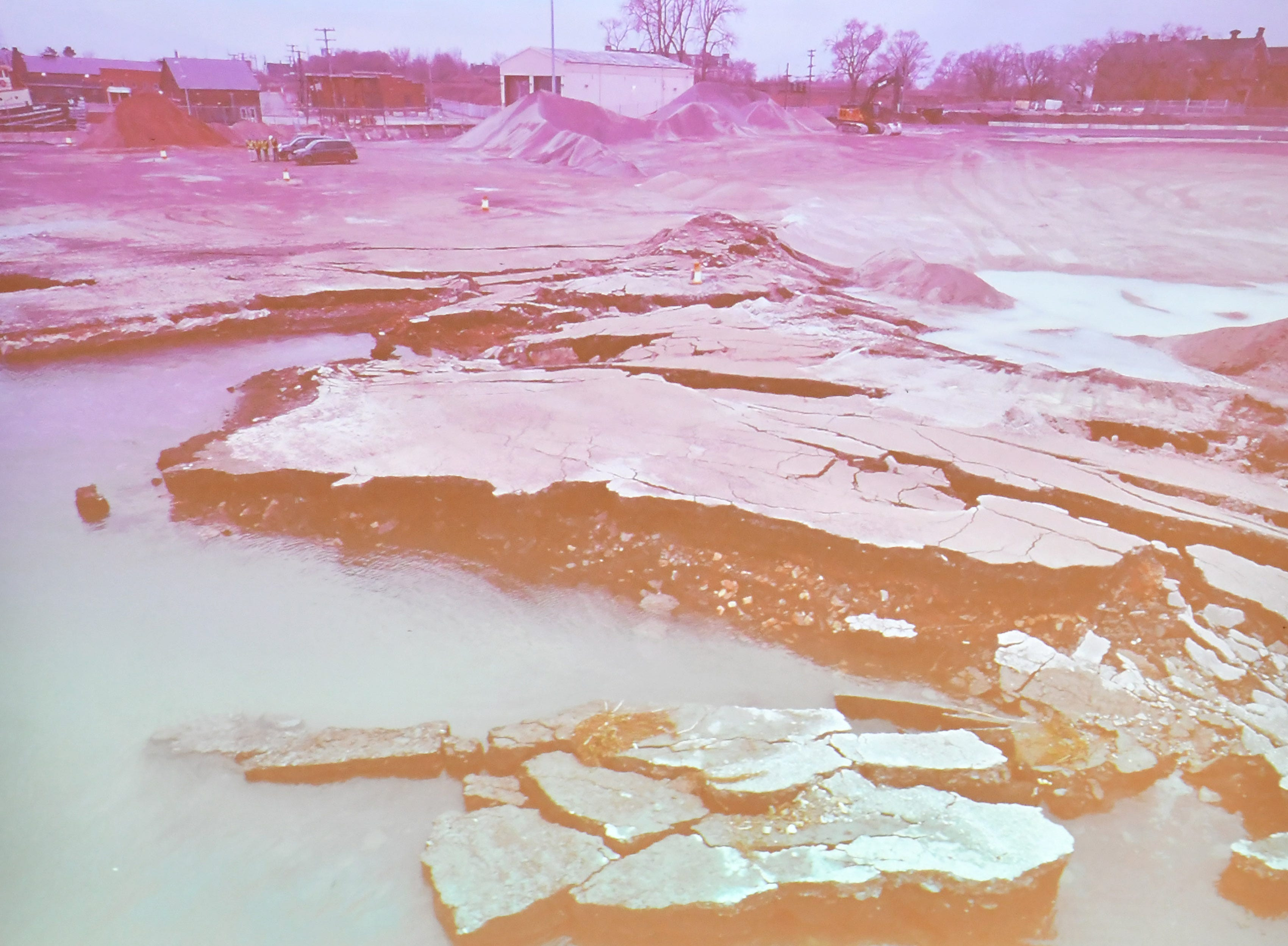 A photo of the collapse shown at the community meeting in response to the Detroit Bulk Storage collapse into the Detroit River at the Cass Corridor Commons in Detroit on Dec. 12, 2019.