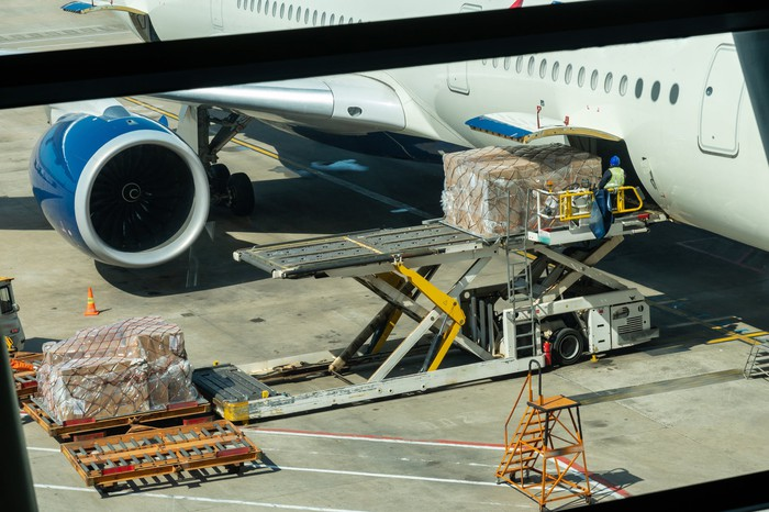 Cargo being loaded onto jet airplane